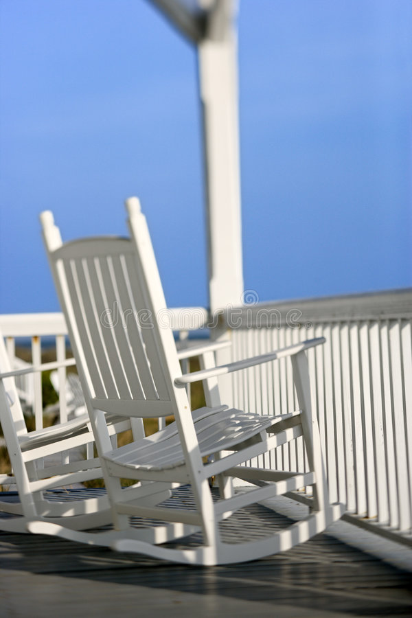 Rocking chairs on porch stock images