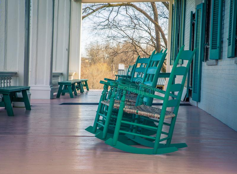 Rocking chairs on a porch stock photos