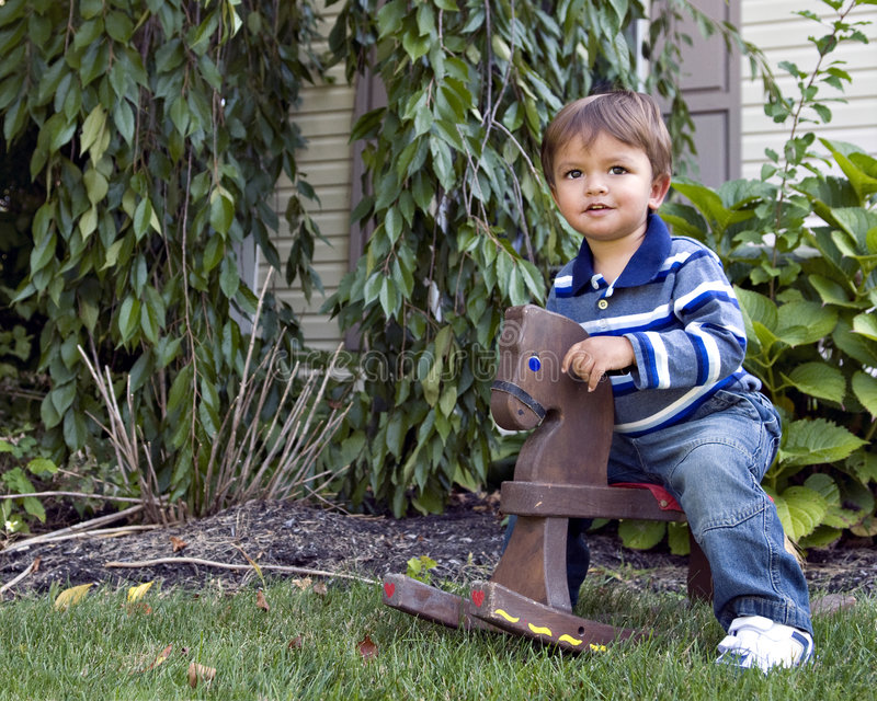 Download Rocking Horse Baby Royalty Free Stock Images - Image: 6582309