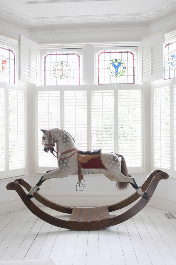 Rocking Horse In Bay Window stock photography