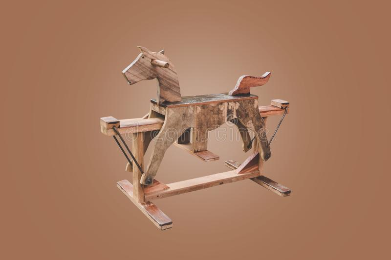rocking Horse isolated on brown background stock image