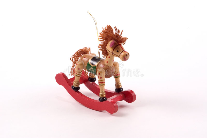 Rocking Horse Tree Ornament. A Christmas tree ornament. Wooden rocking horse with mane of string and red painted accents stock image