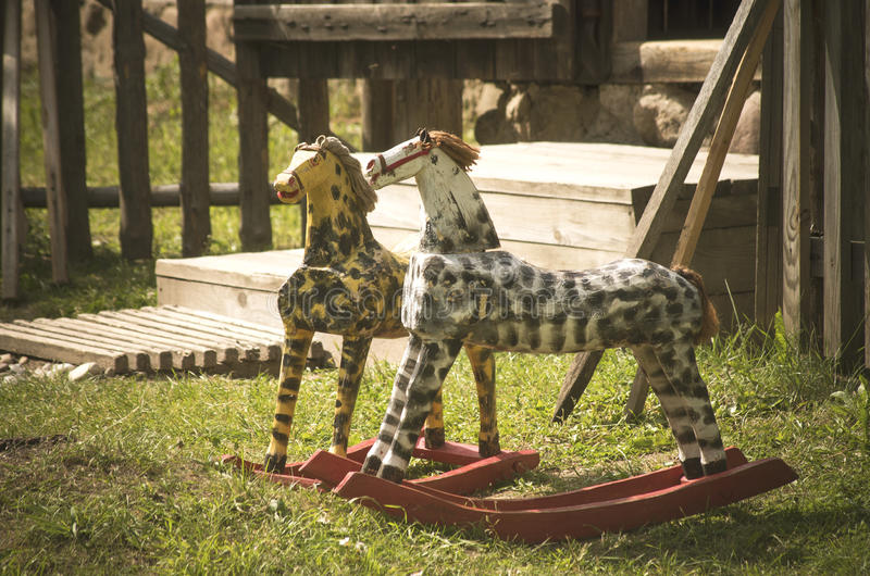 Rocking horses - authentic old toys for kids stock images