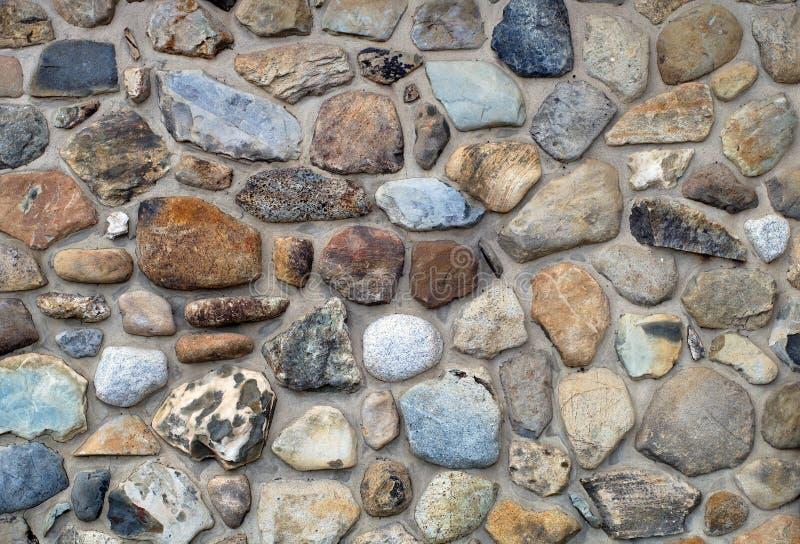 Rockowe kamienne fieldstone ściany betonu szarość ukazują się stałą naturalną teksturę fotografia royalty free