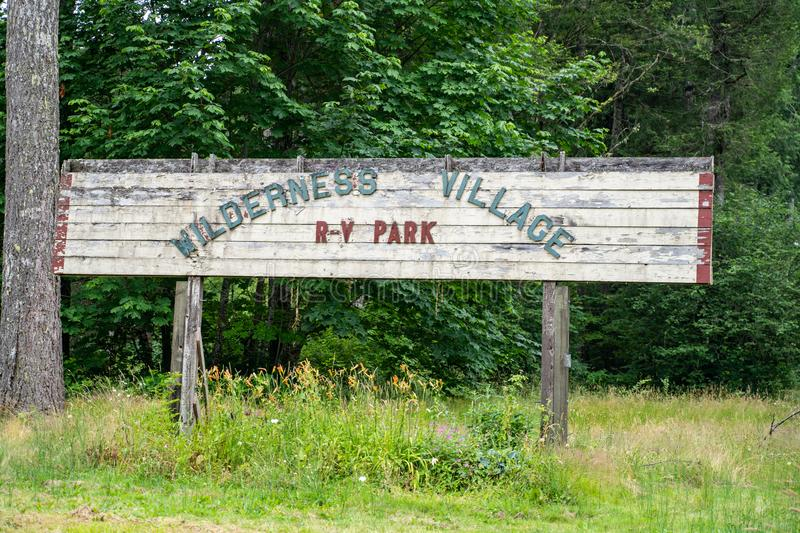 Rockport, Washington - July 6, 2019: Old sign with peeling paint for the abandoned Wilderness Village RV Park stock photos