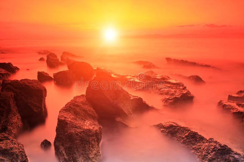 Rocks in Adriatic sea at sunset on Brac island, Croatia stock images