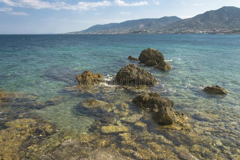 Rocks sea and blue sky, Greek island offshore. Seascape Mytilini. royalty free stock photography