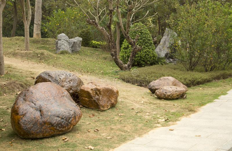 Rocks ,alley and plants arranged in spring park background. Rocks ,alley and plants arranged in spring park, Nanning city China royalty free stock photo