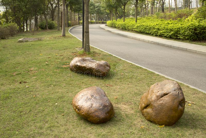 Three rocks ,alley and plants arranged in spring park background. Rocks ,alley and plants arranged in spring park, Nanning city China stock photography