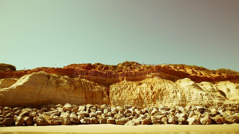 Rocks along seashore stock photos