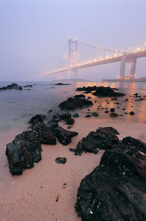 Rocks On The Beach And Bridge Stock Image