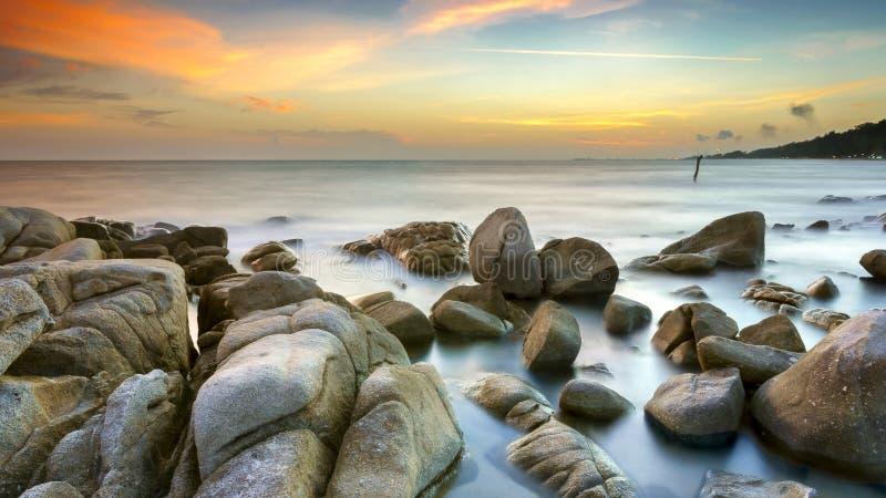 Rocks on beach stock photos