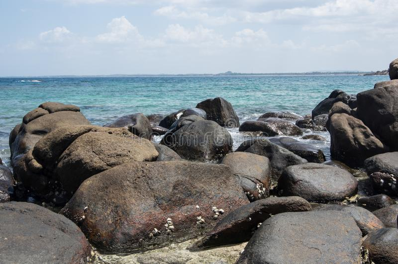 Rocks at the beach of Pigeon Island in Sri Lanka stock photography