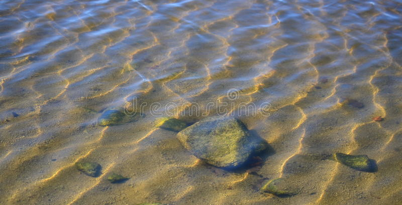 Download Rocks Beneath The Water Surface Stock Photo - Image of background, shallow: 63409902