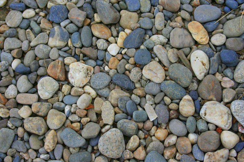 Rocks. Big pile of rocks many with colors royalty free stock photography