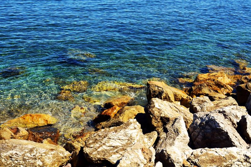 Rocks and blue sea background and landscape stock photo