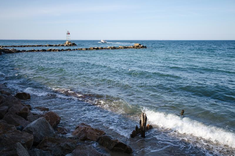 Rocks and breakwaters along the Atlantic ocean on the shore of Marthas Vineyard.  stock images