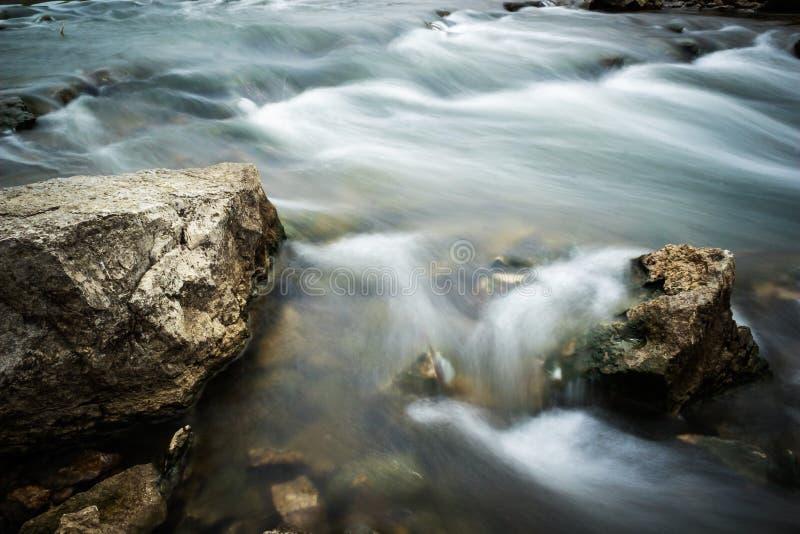 Rocks in a cascading stream royalty free stock photos