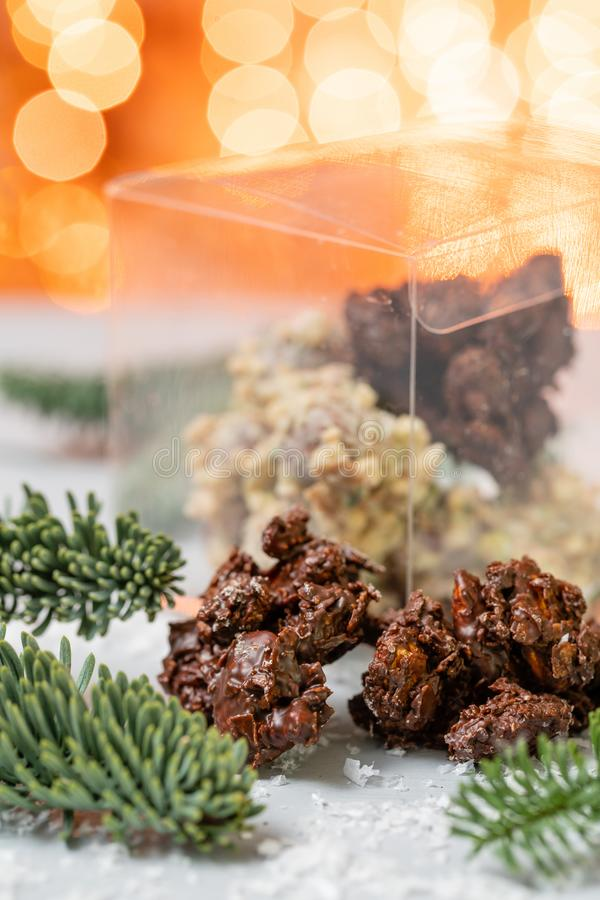 Rocks with chocolate and nuts. Christmas theme. Healthy sweet dessert snack. Granola bar with nuts, fruit, chocolate and royalty free stock images