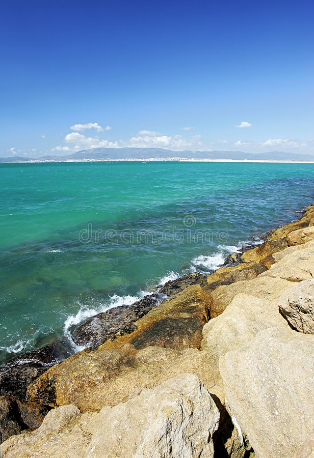 Rocks and clear green sea in Spain royalty free stock photo