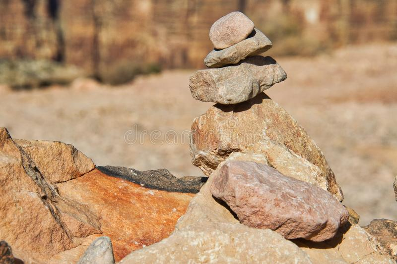 Rocks in the desert stacked together. Rocks in the desert stacked on top of each other stock images