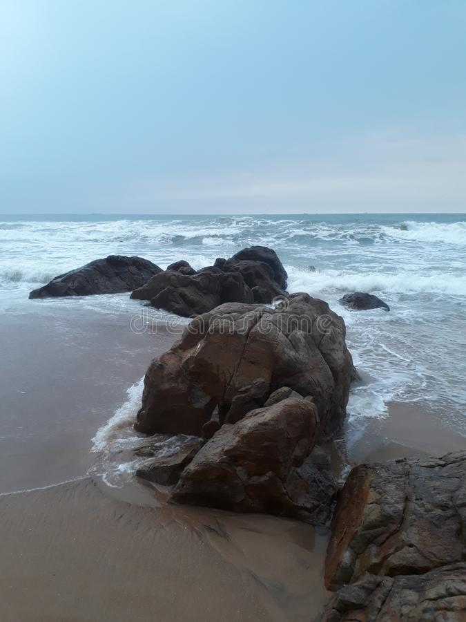 Rocks facing ocean stock photo
