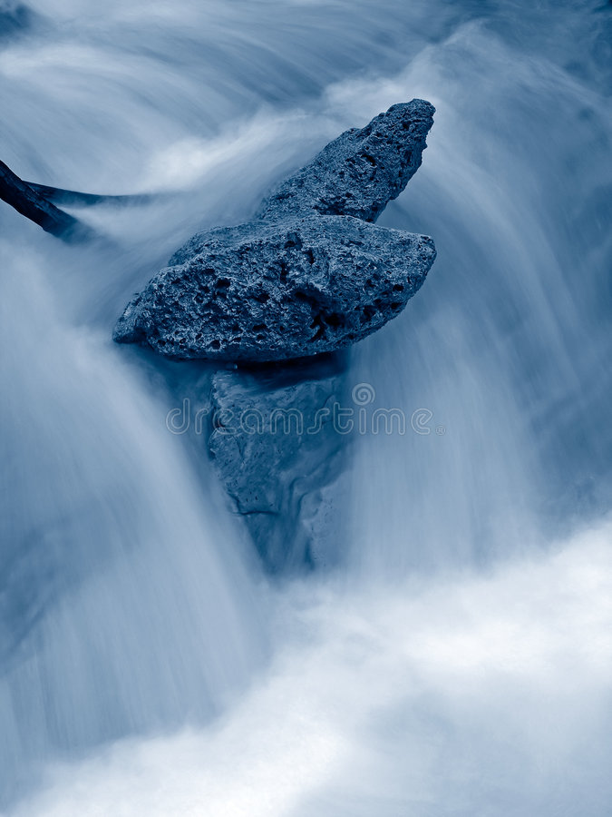 Rocks and falling water royalty free stock photo