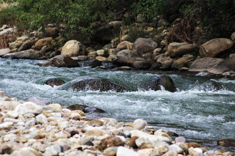 Rocks and flowing water, Corbett National Park, Nainital, Uttarakhand royalty free stock photo
