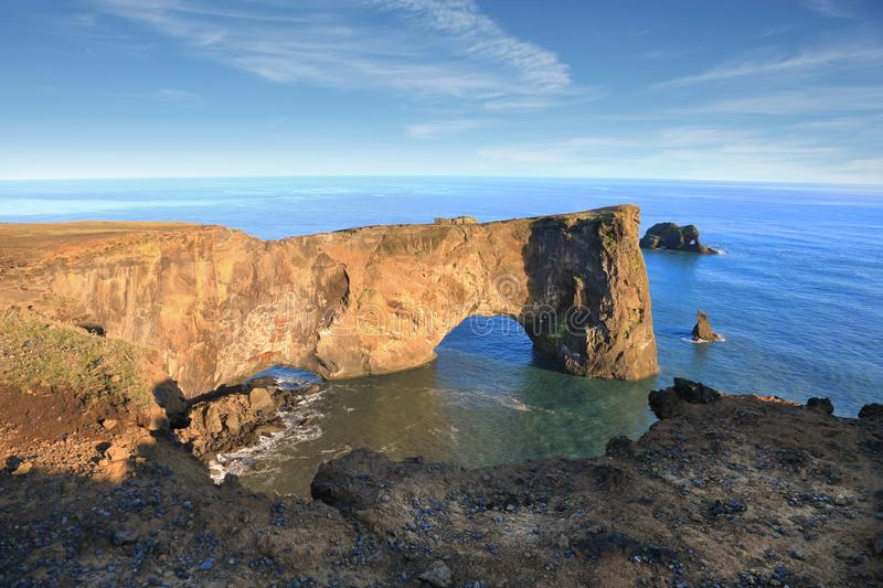 Rock arch at Dyrholaey coast, South Iceland. royalty free stock photography