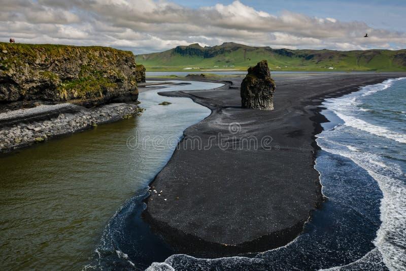 Rocks formation on Dyrholaey cape with black sand beach stock photos