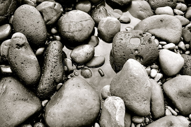 Rocks forming Black Sand Beach on Maui, Hawaii royalty free stock photography