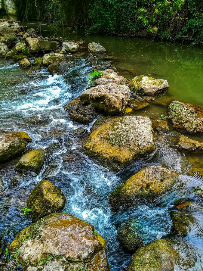 Rocks forming a small dam in the river Palancia. Rocks forming a small dam in the Palancia river as it passes through Segorbe royalty free stock image