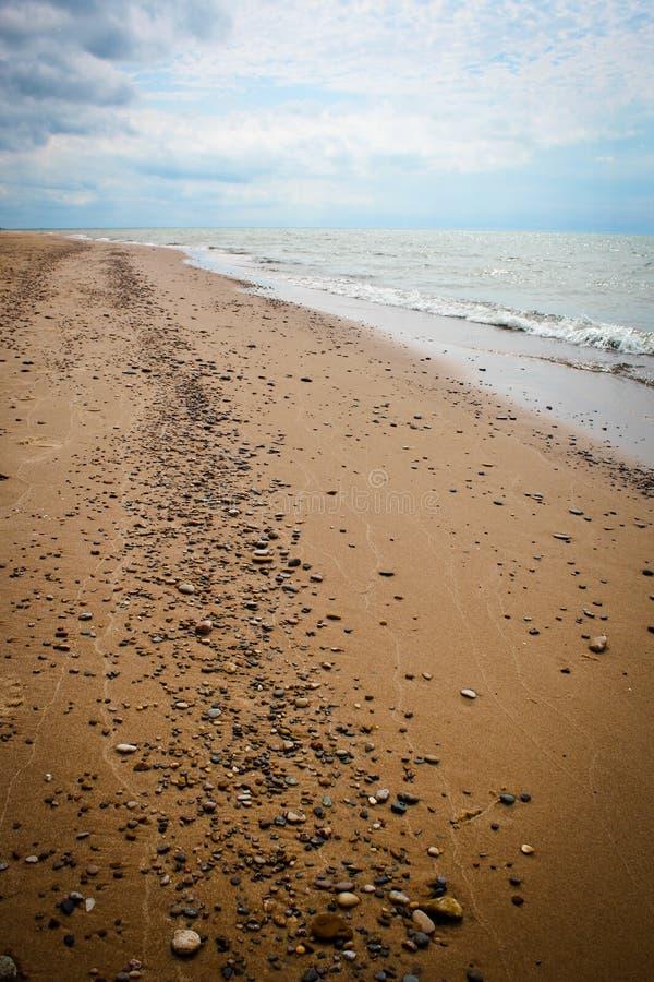 Rocks on Lake Michigan beach stock images