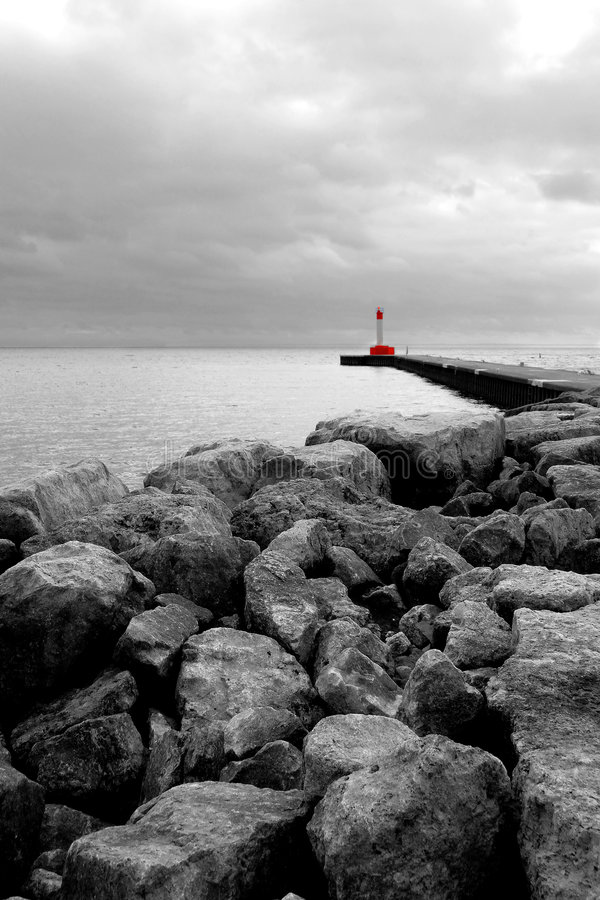 Rocks and Lighthouse royalty free stock image