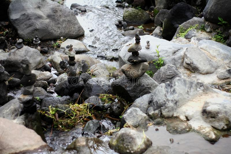 the rocks in the middle of the river royalty free stock photography