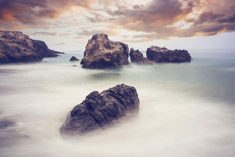 Rocks and mists by the ocean royalty free stock image