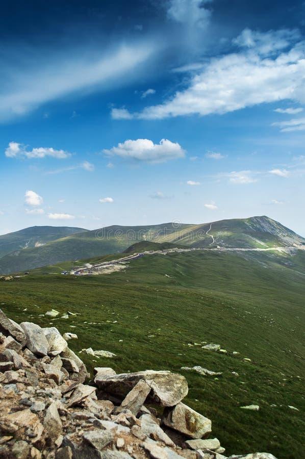 Rocks mountain green blue sky royalty free stock photography