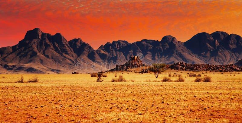 Rocks of Namib Desert. Colorful sunset in Namib Desert, Namibia royalty free stock photos