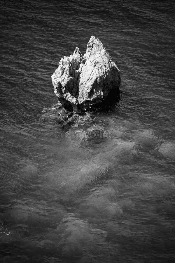 Paleokastritsa rocks - Corfu Island, Greece. Rocks near Paleokastritsa in b&w, Corfu Island, Greece, Europe. Vertical composition royalty free stock images