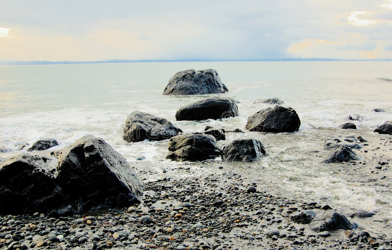 Rocks in the Ocean Surf. In the sunny winter day royalty free stock image