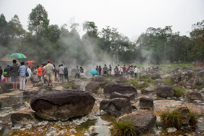 Rocks and people around the hot springs royalty free stock photo