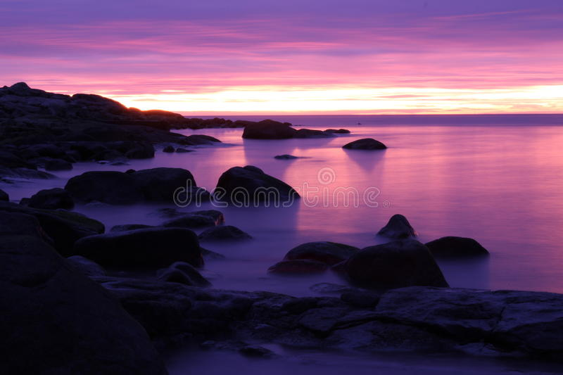 Rocks in a purple nordic winter sea. Rocks on a smoky cold winter sea at the Swedish West cost royalty free stock image