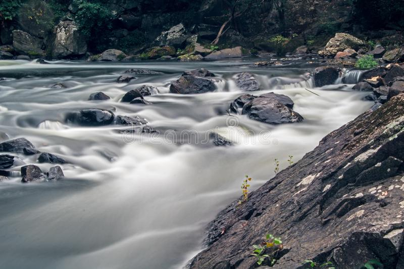 Rocks In The Rapids On The Yamaska River In Granby, Quebec. Long exposure view of rapids on the Yamaska River in Granby, Quebec, Canada, just below the remnants stock photos