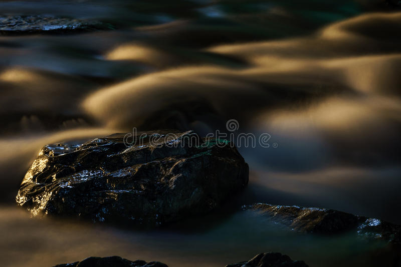 Rocks and River at Night royalty free stock photography