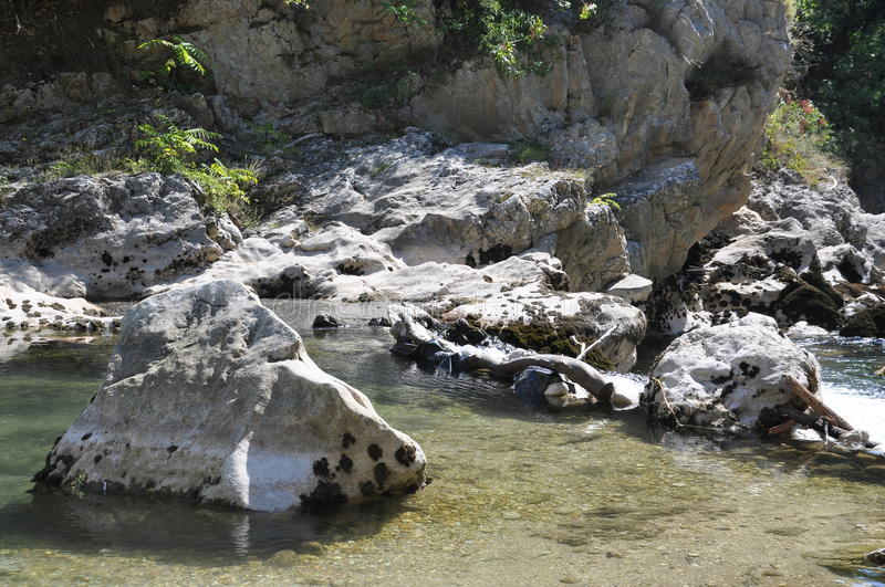 Rocks in the river. With splashing water royalty free stock images