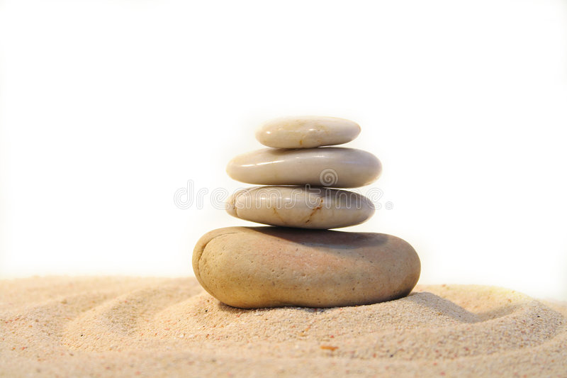 Rocks and sand. Pebbles stacked on sand stock photo