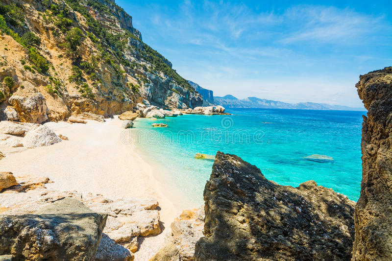 Rocks and sand in Cala Mariolu royalty free stock photos