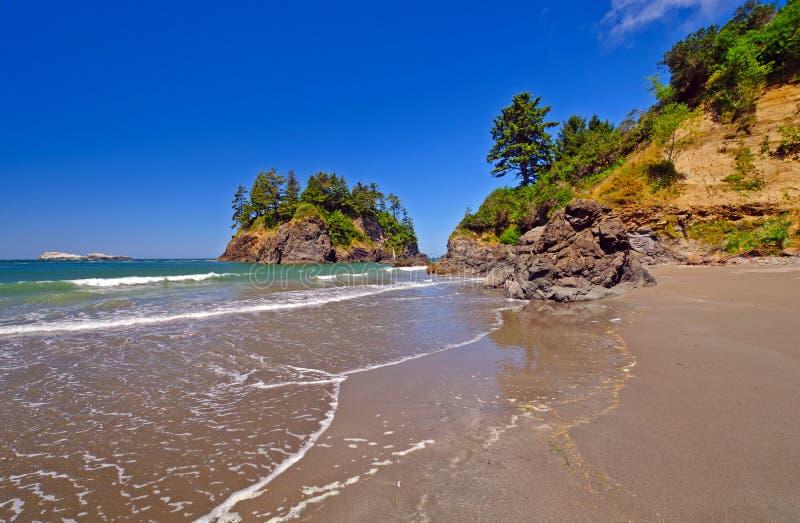 Rocks And Sand On A Pacific Coast Beach Stock Photos