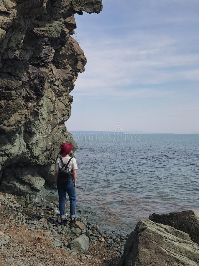 Rocks, the sea and the girl royalty free stock images