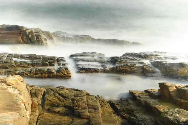 Rocks and the sea. With Long Exposure. Took the photo in Huidong, Guangdong, China royalty free stock images